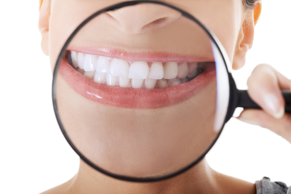 magnifying lens over teeth